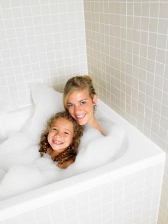 Sisters in a bath, foam Banque d'images