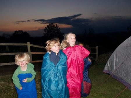 Sleeping bag races at dusk 스톡 콘텐츠