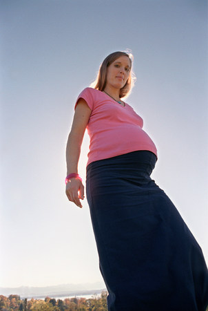 pregnant woman standing outside