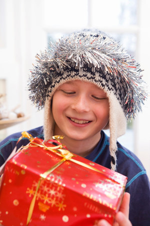 Boy, 10 holding present Stock Photo