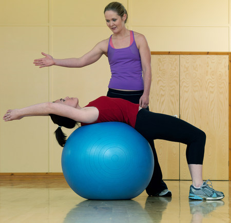 women relaxing at gym with exercise ball
