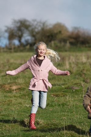 Girl running in countryside
