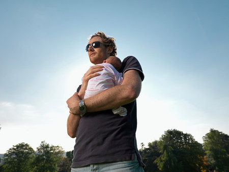 Man with baby in park