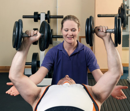 man exercising with weights at gym