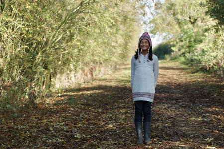 Girl on country lane Stock Photo