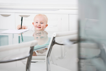 Portrait of a baby in an office chair