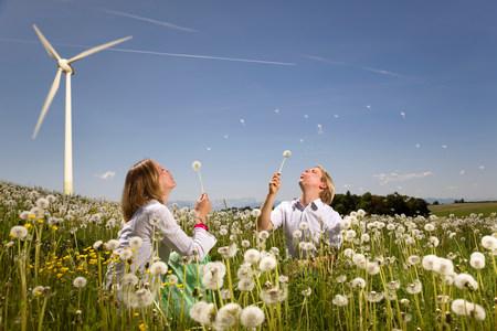 man and woman at wind turbine