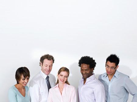 A business team admiring work