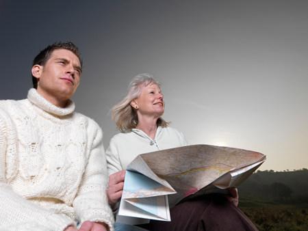 man & woman studying map Stock Photo