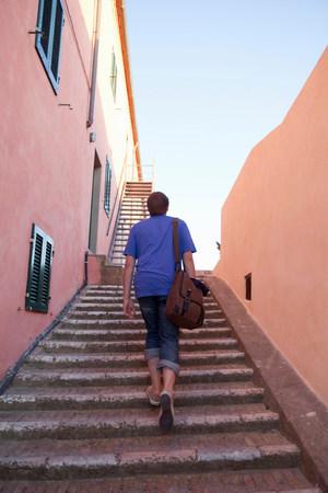 Man walking up stone stairs