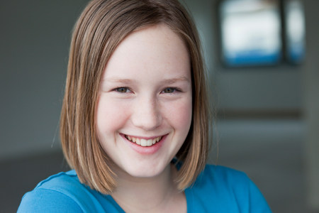 young girl smiling at viewer Stock Photo