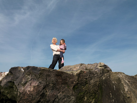 mature woman with child on rocks