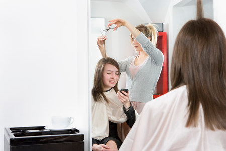 Female talking on phone at hairdressers