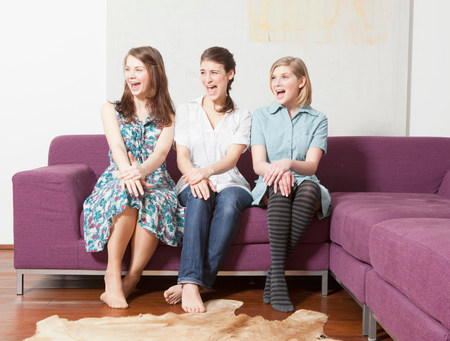 Three women on a sofa, screaming. Stok Fotoğraf