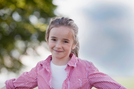 young girl playing smiling at viewer