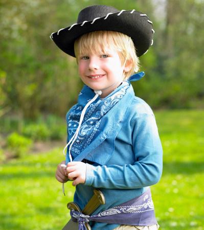Boy wearing a cowboy costume Stock Photo