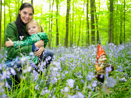 Mother and daughter next to garden gnome