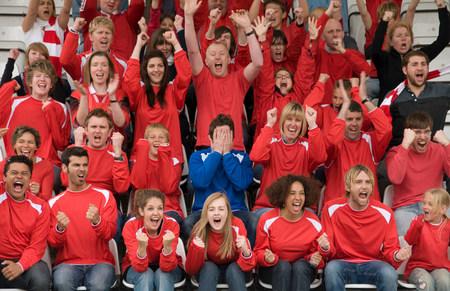 Fan amongst rivals at football match