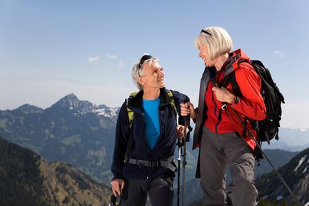 couple talking on ski tour in mountains