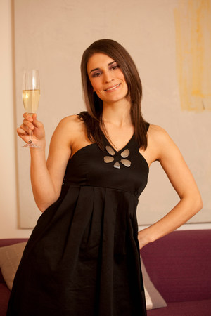 Young woman holding glass of champagne
