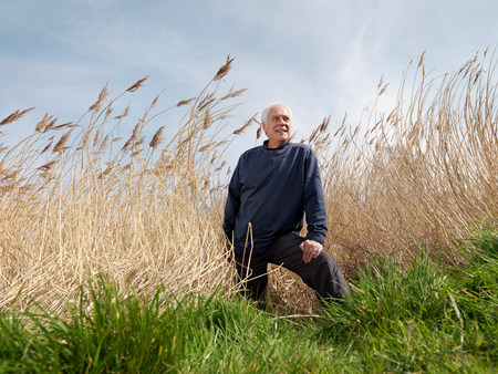 mature man standing in reeds