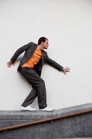 man walking on railing Stock Photo