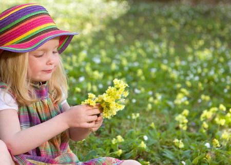 girl picking spring flowers