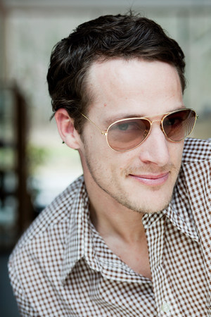 man with sunglasses smiling at viewer