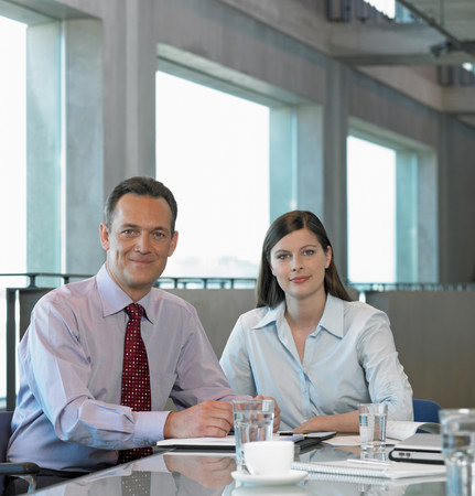 Two Businesspeople sitting at table