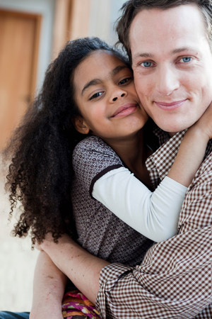 young girl and man embracing