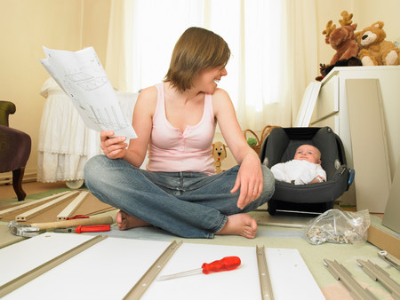 Woman and baby building furniture Banque d'images