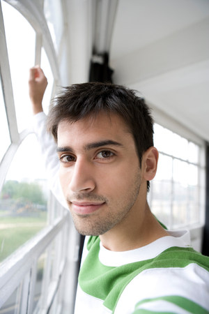 Portrait of a man alongside a window. Stock Photo