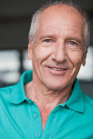 old man smiling at viewer