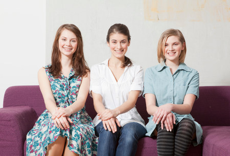 Three women on a sofa