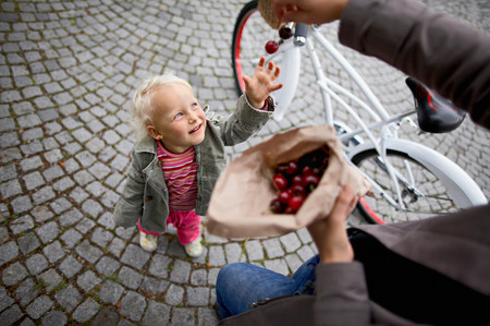 Little girl wants to have cherries