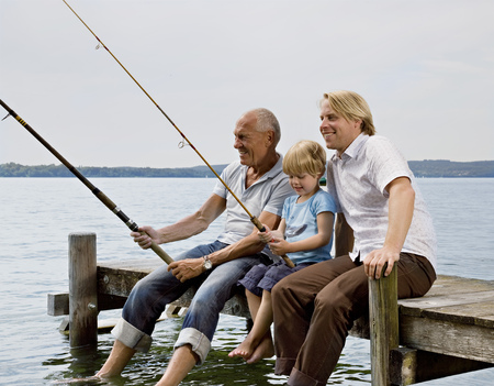 boy fishing with grandfather, father Banco de Imagens