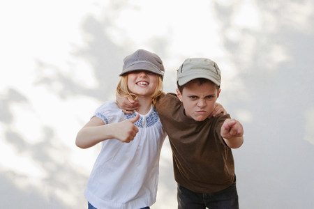 Boy pointing with girl giving thumbs up