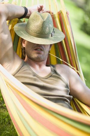 Man sleeping in a hammock Stock Photo