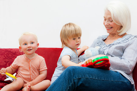 A grandmother playing with two toddlers Banco de Imagens - 113926420