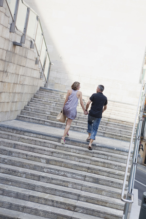 couple walking up stairs