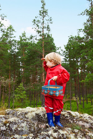 Toddler standing on rock in forest