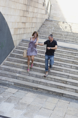 couple running down stairs