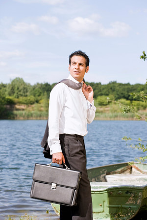 businessman in front of rowboat