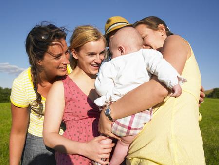 women admiring baby