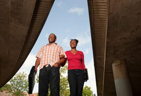 man & woman walking to work