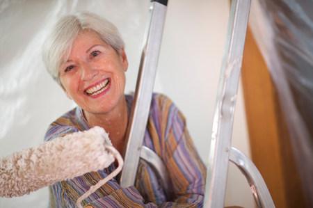Mature woman doing DIY Фото со стока