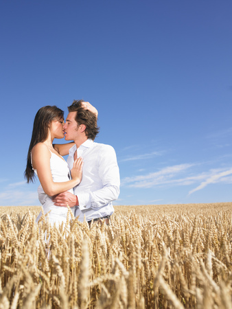 young couple in wheat field