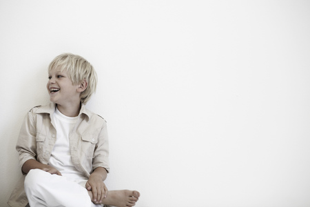 Portrait of young boy laughing Stock Photo