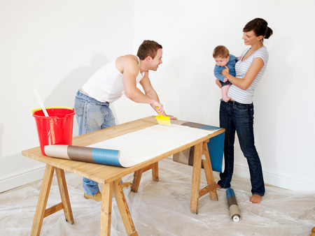 Couple preparing wallpaper