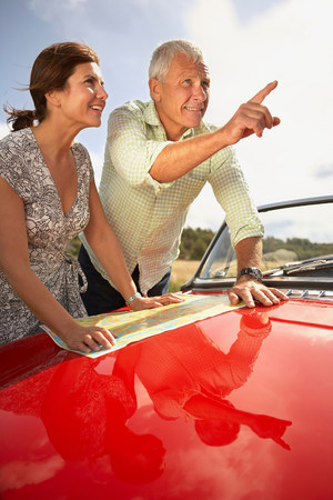 senior couple with car and map Banco de Imagens - 114014283